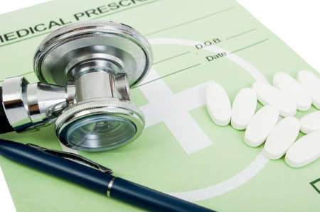 Medical precscription concept with green official paper, pills and stethoscope photo