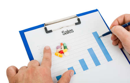 stock predictions: International pill sales growing chart on clipboard concept