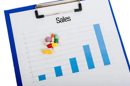 sales chart: Pills manufacturers growing sales chart on clipboard Stock Photo