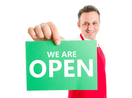 supermarket: Open sign concept hold by supermarket employee or worker Stock Photo