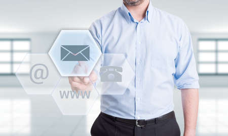 mail address: Contact us using mail address concept with man pressing button on transparent futuristic touch screen