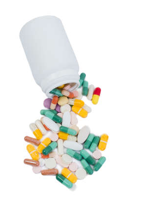 analgesics: Spilled pills and recipient isolated on white background