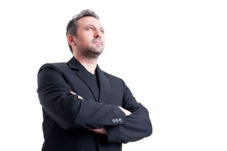visionary: Confident and visionary business man posing from low angle looking up with arms crossed