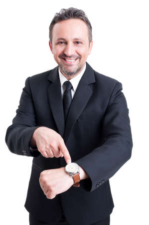 reminder concept: Business man showing the watch as meeting reminder concept