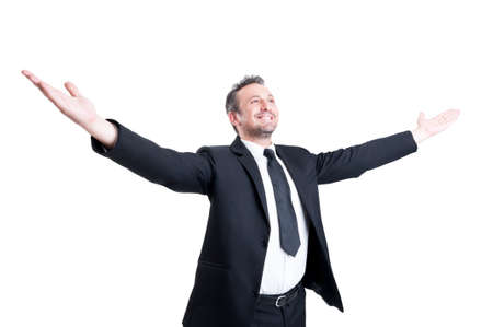 arm raised: Very successful business man, banker, lawyer or accountant stretching arms wide open expressing independence, success, positivity and victory Stock Photo