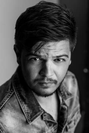 macho: Black and white portrait of a handsome macho or badboy wearing jeans jacket Stock Photo