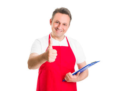 Friendly hypermarket employee holding clipboard and showing thumb up