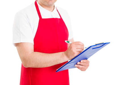 storekeeper: Storekeeper or shop administrator holding clipboard with checklist