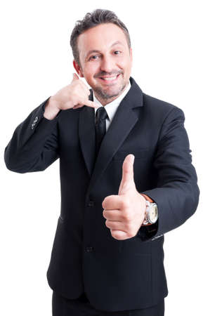 man thumbs up: Business man making positive call us and thumb up gesture Stock Photo