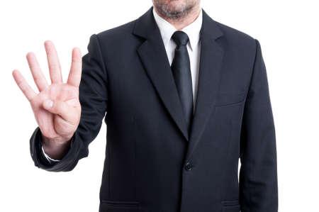 elegant business man: Uomo elegante di affari che mostra il numero quattro con le dita. Direttore esecutivo o imprenditore gesto