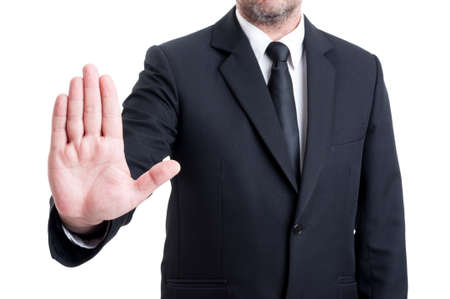 anonymus: Anonymus business man showing stop gesture by raising palm to the camera