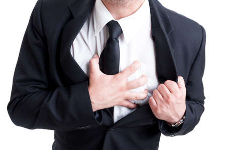 heartattack: Business man having heart attack and grabbing his chest in pain