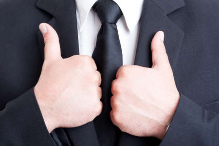 business like: Double business like concept with male hands holding suit jacket collar