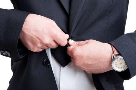 unbutton: Rich business man buttoning or unbuttoning expensive suit jacket