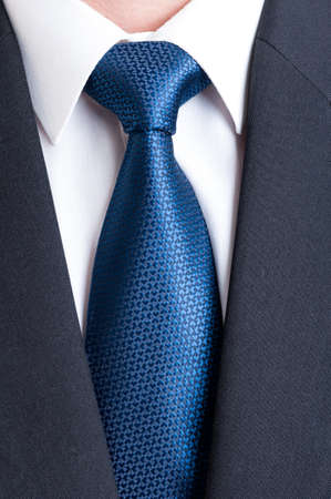 Black suit, white shirt and blue tie. Business, financial or politic concept