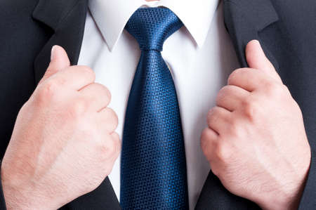 suit: Business man chest as powerful leader concept. Black suit, white shirt and blue tie Stock Photo