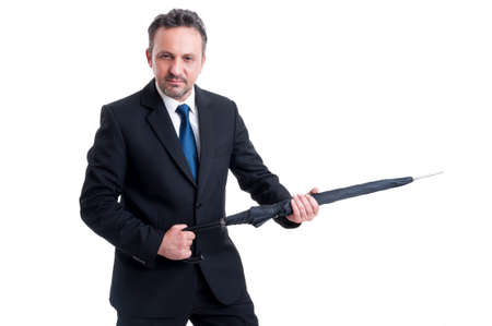 riffle: Powerful and dangerous business man holding an umbrella like a riffle or gun