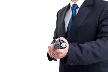 sicario: Hombre de negocios, asesino a sueldo o agente secreto especial que sostiene el paraguas como un rifle