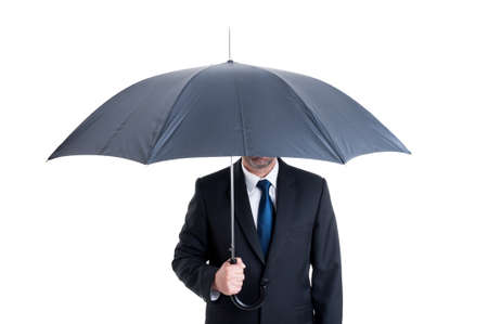 anonymus: Anonymus business man with an open umbrella. Protection or insurance from financial risk concept Stock Photo