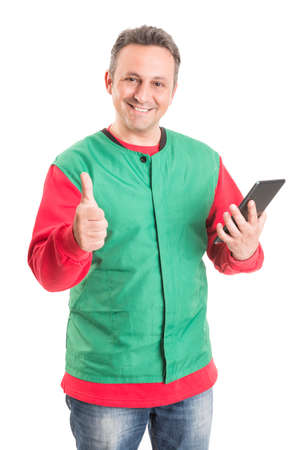 thumbup: Supermarket employee using wireless tablet and showing thumb-up or like gesture Stock Photo
