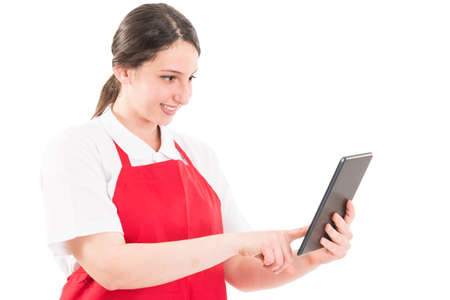 Modern woman supermarket employee using wireless tablet to check stock photo