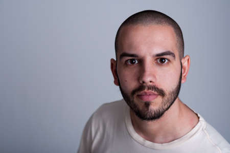 Portrait of a handsome young man with short hair and beard Stock Photo