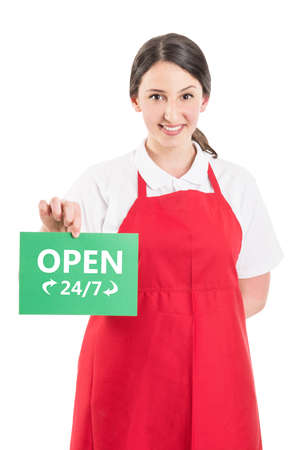 isolated sign: Female hypermarket worker holding open 247 or nonstop sign