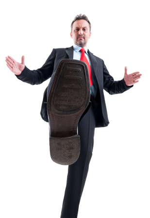 treading: Business man treading or stepping on competitors Stock Photo