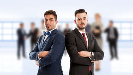 Business people back to back standing confident as competitors or partners Stock Photo