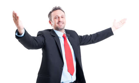 Business man with open arms looking into the camera on white background photo