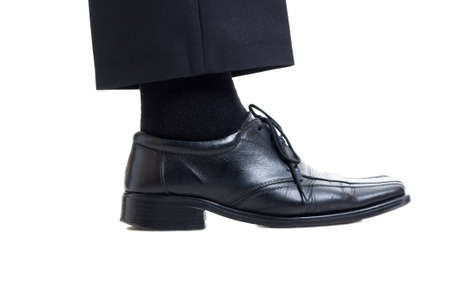 Classic black suit pants, sock and leather shoe isolated on white background. Business manager foot concept