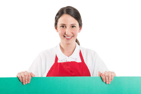 copyspace: Female supermarket employee holding green board with copyspace for text