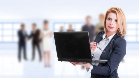 kinky: Woman business manager with goggles and laptop and business people background Stock Photo