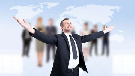 outspread: Successful business man with arms outstretched or outspread with business people background