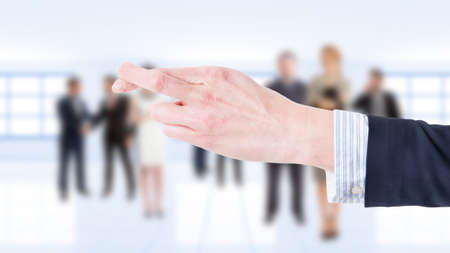 finger crossed: Business woman hand showing finger crossed on business people background