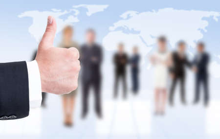approbation: Business man hand showing like or thumbup on business people background