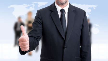 anonymus: Anonymus business man showing like on business people background Stock Photo