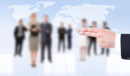 hitman: Business man hand showing pistol gesture on business people background Stock Photo