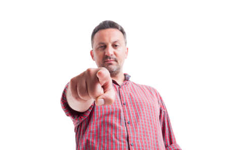 Charismatic man gesturing you are fired, hired or selected in a low angle or hero shot image