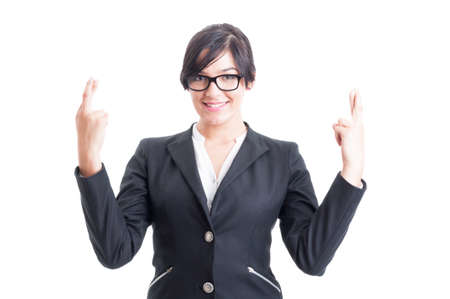 falsehood: Business woman wishing for luck with crossed fingers. Good luck with cross fingers concept Stock Photo