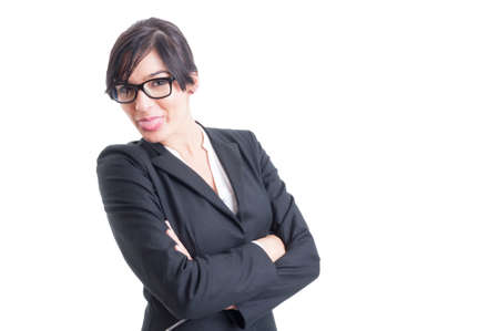 Beautiful business woman sticking tongue out, acting funny and cute photo