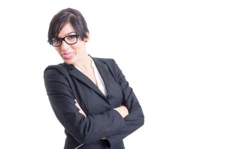 lengua afuera: Hermosa mujer de negocios que pega la lengua hacia fuera, actuando divertido y lindo Foto de archivo