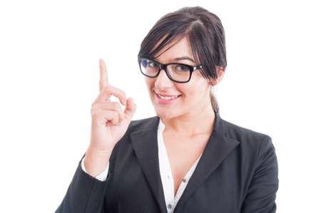 poner atencion: Mujer de negocios poiting dedo hacia arriba o tener una idea. Preste atenci�n al concepto de profesor