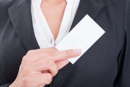 hand on chest: Anonymous business woman holding a blank business card with copy space or copyspace Stock Photo