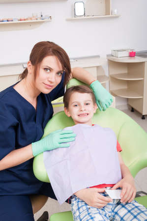 dentist concept: Kid patient smiling in dental office. No fear of dentist concept Stock Photo