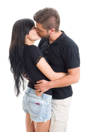kissing lips: Beautiful brunette couple kissing and hugging on white studio background