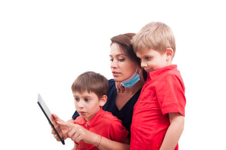dentist concept: Modern female doctor and kid patients using wireless tablet. Friendly woman dentist concept