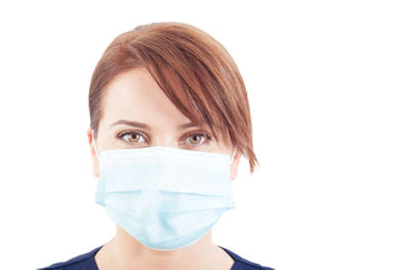 surgical mask woman: Beautiful face of a woman doctor wearing surgical mask isolated on white background