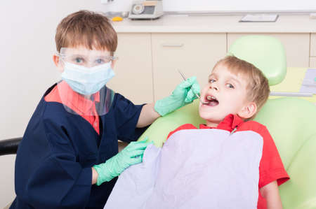 no fear: Kids playing in dental office. No fear of dentist concept Stock Photo