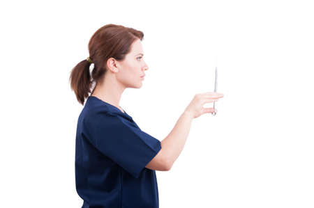 anesthetic: Beautiful female dentist doctor preparing syringe with anesthetic Stock Photo